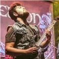 Guitarrista profesional se ofrece para dar clases de guitarra presenciales u online